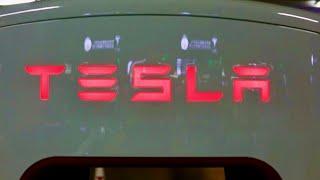 Tesla shares turn negative after billing practices were challenged